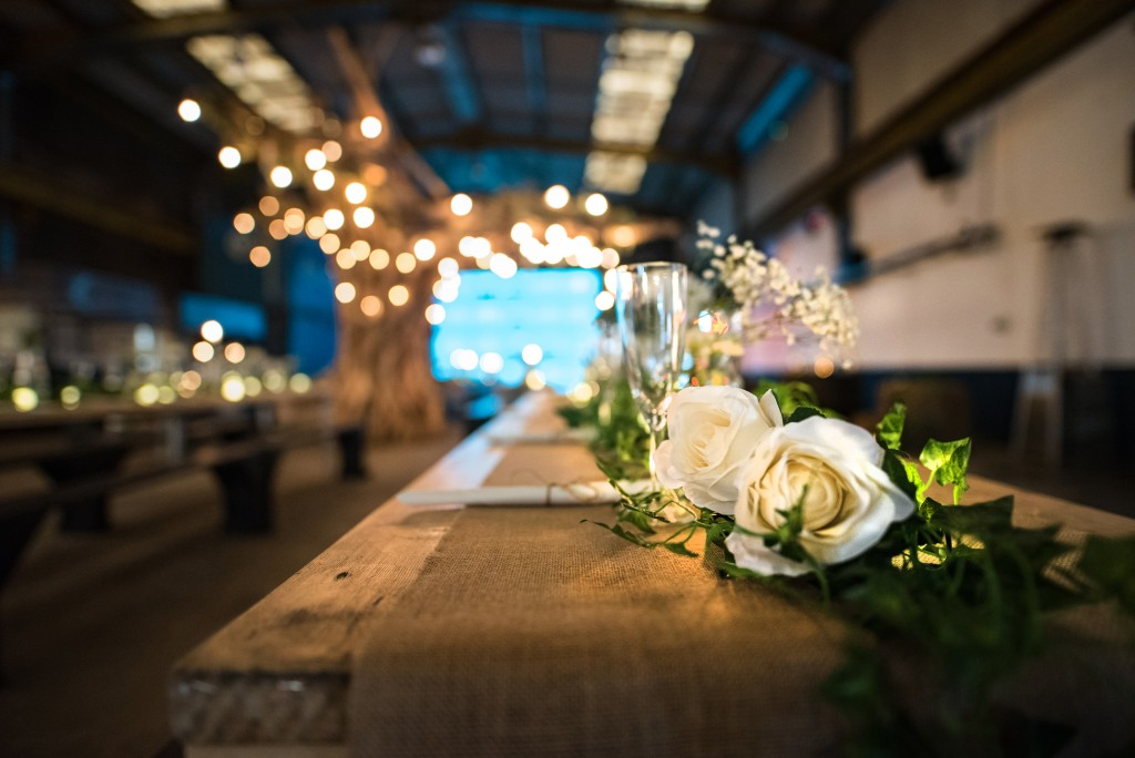 Depot set up for wedding with white roses